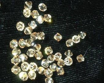72 pieces (half gross)  Swarovksi 4mm Crystal Bicones, Crystal Golden Shadow