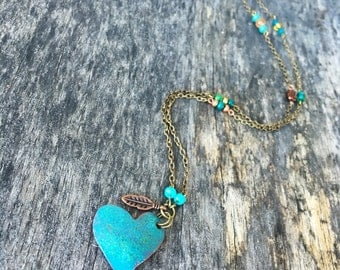 One of a kind necklace with enamel copper heart, glass beads and copper feather