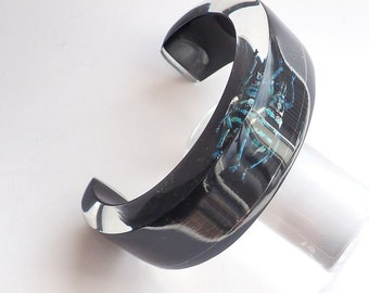 Funky open blakc lucite bracelet with real insect