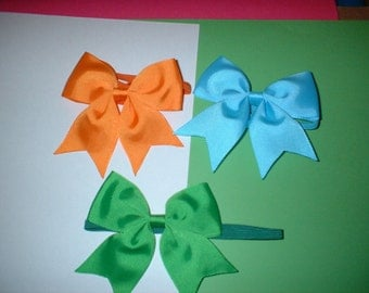 4  inch  Hair Bows on Headbands In  colors( 11)  total of 6
