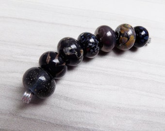 Black and brown lampwork bead strand