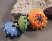 Handmade Lampwork Beads by Monaslampwork - Bright Orange Compass Focal and Others- Lampwork Glass Beads by Mona Sullivan Organic Tribal Boho
