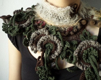 statement knitted scarflette in olive green, brown, cream, burgundy, camel and taupe gray colors with big crocheted flowers