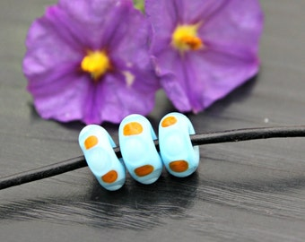 Set of Three Handmade Artisan Lampwork Glass Beads in Baby Blue With Orange Dots