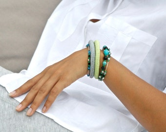 Crochet wrap bracelet with glass beads in light green, grey and turquoise