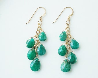 genuine emerald and gold dangle earrings