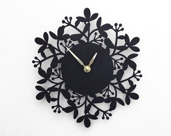 modern wall clock, black and gold, foliage design, wood clock