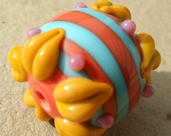 Lampwork Hollow Bead with flower petals stripes and dots in coral, sky blue, yellow ocher, and rose pink