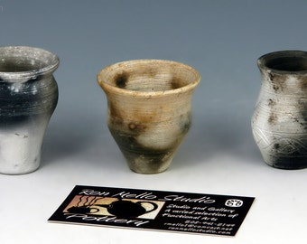Three miniature pit fired pots.