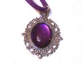 purple pendant necklace on velvet cord