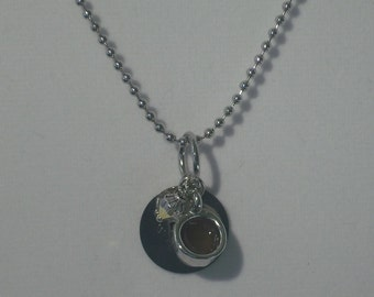 Tiny teacup and stamped metsl drink me charm necklace