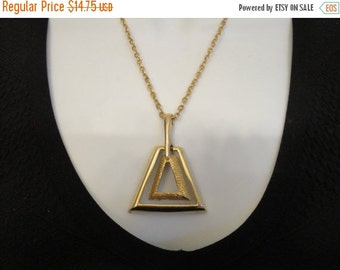 Christmasinjuly SALE Vintage metal pendant in dual triangular shape on gold tone chain 18 inch long chain, 2  inch pendant, Barrel style cla
