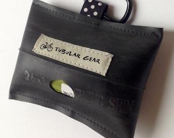 Black with white polka dots bag dispenser
