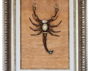 Steampunk Scorpion Wire Sculpture with antique watch movement, victorian filigree locket and uranium glass.
