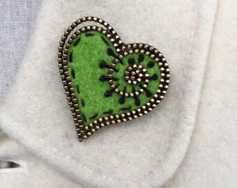 Bright green felt and zipper heart brooch