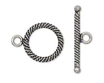 Two Antiqued silver plated copper clasps, round and textured, 17mm.