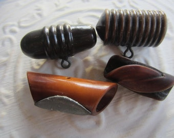 Vintage Buttons - lot of 4 assorted brown celluloid novelty toggles (mar 202)