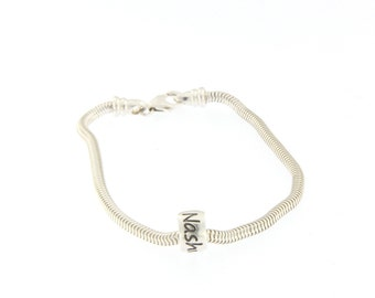 Sterling silver charms bracelet with one cursive font charm. If you would like more charms please choose.  Great gift idea