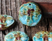 Pottery Bead with Cross in a Worldly Mix of browns, blues and greens