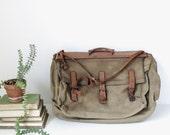 vintage canvas garment bag with leather trim