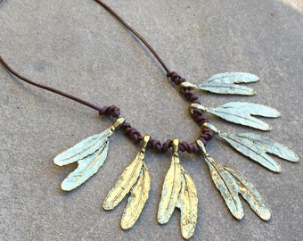 Gold feather leather necklace