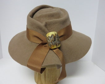 Camel colored floppy brimmed fedora with free formed crown and pleated brim in back