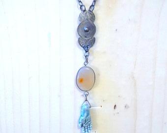blue water hands: amulet necklace