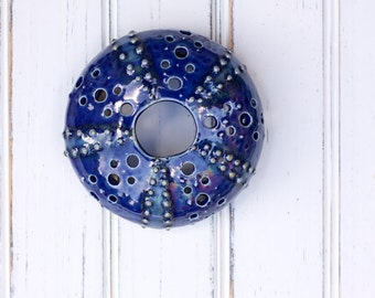 small urchin wall hanging, urchin tabletop sculpture, dark blue
