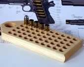 Maple reloading block with standard depth holes for pistol calibers