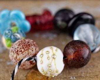 Destash........ sale........ clearance... set of 9 orphan beads......... sra