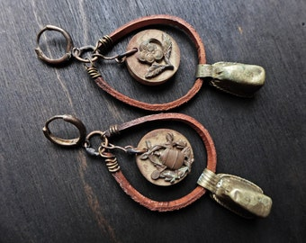 Vespertide. Rustic assemblage earrings with African prayer beads, game pieces, leather.