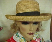 """Straw hat with black grosgrain band by (Filippo Catarzi) made in Florence, Italy- fits 22 """""""