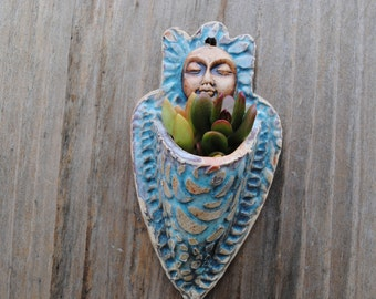 ceramic wall planter figurative garden art sculptural plant holder