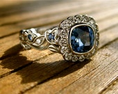 Blue Sapphire Engagement Ring in Platinum with Sapphires in Flower Buds and Diamonds in Leafs Size 5