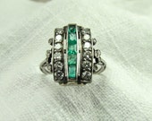 Circa Mid 20th Century Diamond and Emerald Ring