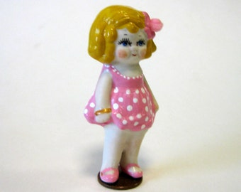 "Penny doll 3"" Dolly Dingle cast in white porcelain dressed in pink polka dots"