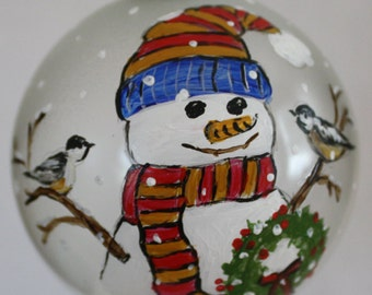 Snowman with Birds painting on a glass ornament