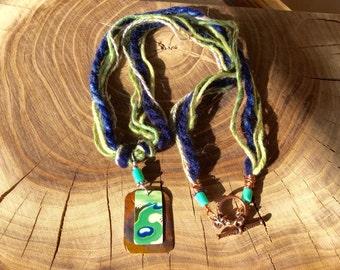 Hand spun fiber necklace with copper and vintage tea tin pendant.