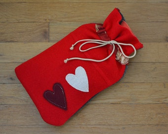 Hot water bottle cover in red felted wool with 2 hearts
