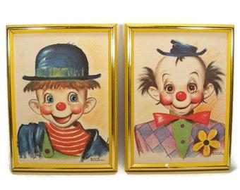 Pair of Dianne Dengel Clown Prints framed in Yellow Wooden Frame
