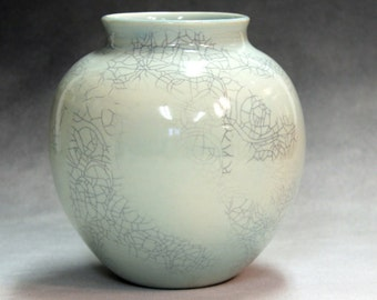 Porcelain traditional shaped, hand made, ceramic vase  blue green celadon with crackle glaze with shipping included in the selling price.