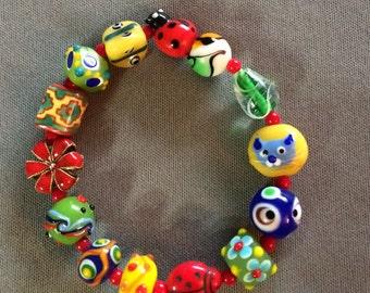 ladybugs and kitty red, green blue kaleidoscope bracelet