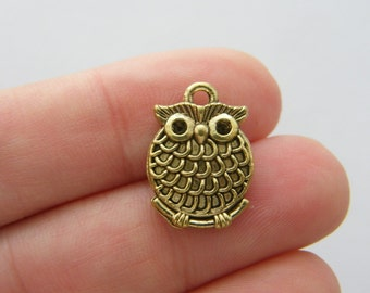 8 Owl charms antique gold tone GC42