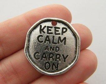 2 Keep calm charms antique silver tone M558