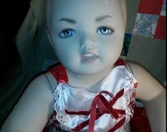 Beautiful blue eyed mannequin figurine toddler.