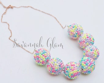 Drop down bubblegum beaded sparkle necklace on brass chain.