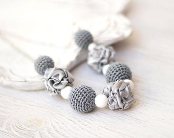 Grey necklace with crocheted and fabric beads