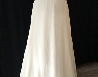 Bohemian wedding dress with golden details.