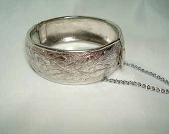 1984 Silver Tone Etched Flower Bangle Bracelet with Safety Chain.