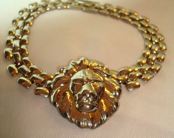 1980 Gold Tone Lion Head Linked Bracelet.